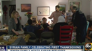Families of different faiths come together for Thanksgiving dinner - Video
