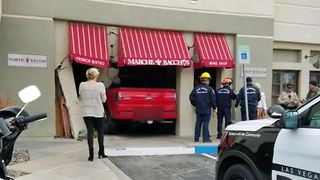 Truck crashes into Desert Shores restaurant - Video