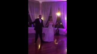 Bride and groom perform choreographed first dance