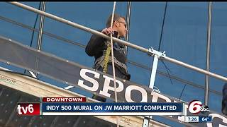 IndyCar driver Ed Carpenter helps put decal on JW Marriott downtown - Video