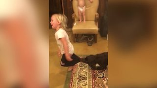 Tot Girl Loses Tug Of War With Dog