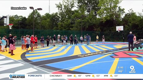 Norwood High School students help renovate, reopen basketball court