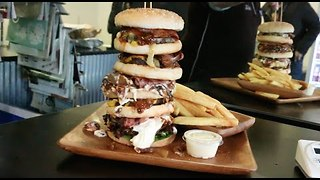 Competitive Eater Smashes Mexican Burger Challenge - Video