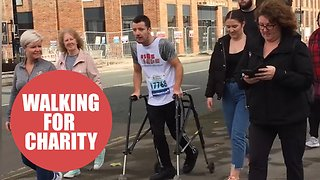 Football coach told as child he will never walk completes two marathons - Video