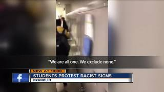 Students march for inclusion following racist water fountain signs - Video