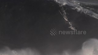 Surfer takes on monster wave off Portugal coast - Video