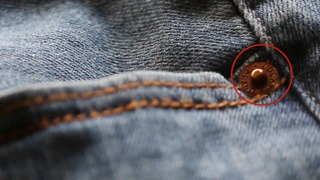 Circular Metal Pieces Around Jean Pockets Actually Have An Important Purpose  - Video
