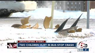 2 children, 2 adults injured as car slides into bus stop on Indy's northeast side