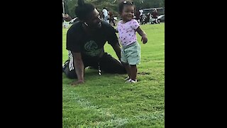 Baby girl walks to her dad for hugs & kisses