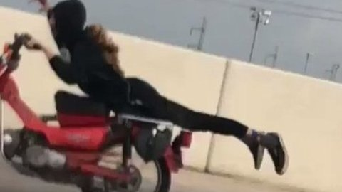 Daredevil Motorcyclist Performs Stunt on San Antonio Highway
