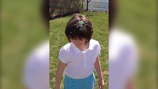 A Cute Girl With Confetti On Her Head - Video