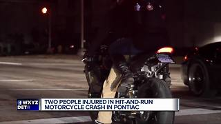 Two people injured in hit and run motorcycle crash in Pontiac - Video