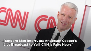 Random Man Interrupts Anderson Cooper's Live Broadcast to Yell 'CNN is Fake News!' - Video