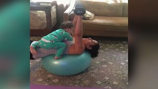 Baby Distracts Mom From Workout - Video
