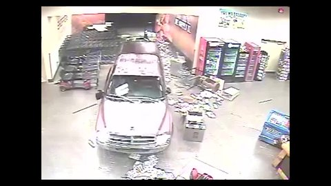 Suspects crash into store to steal 21 guns