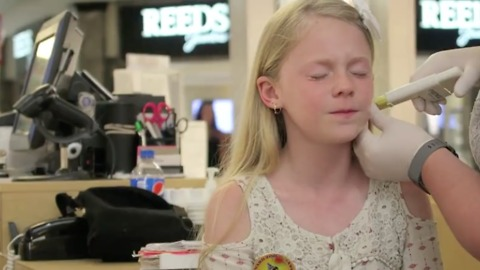 11 year old gets her ears peirced. Shocking reaction!!