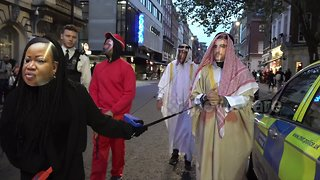 Activists dressed as Saudi royals join protest at London embassy - Video