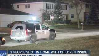 2 people shot in home with children inside - Video