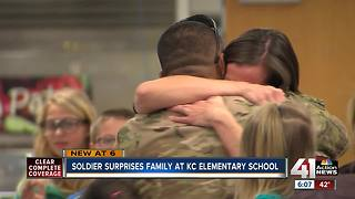Military dad surprises wife, kids at KC school - Video