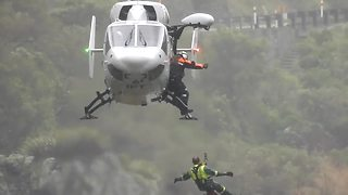 Amazing high wind helicopter rescue - Video