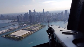 One of a kind WWII aircraft flies across Chicago skyline - Video