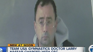 Olympics doctor charged with abusing children