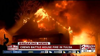 Crews battle house fire in north Tulsa