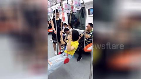 Chinese woman brings own 'swing seat' on train