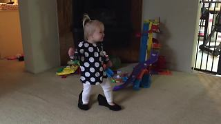 Little Girl Walks Around In Mommy's Shoes - Video
