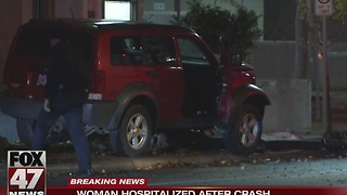 Woman sent to hospital after crash - Video