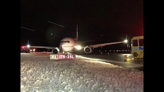 Plane slides off Taxiway at DIA