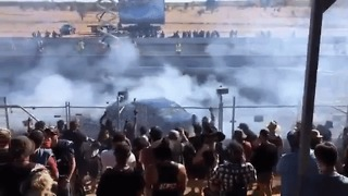 Car Sprays Burning Fuel Into Crowd During Motor Event - Video