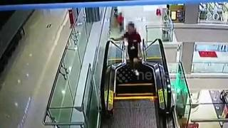 Woman uses escalator as budget treadmill - Video