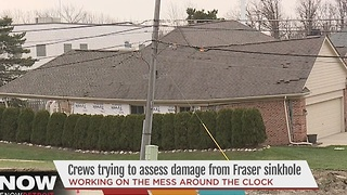 Crews working to assess damage from Fraser sinkhole - Video