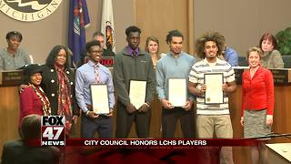 Lansing Catholic football players who knelt during anthem to be recognized at council meeting - Video