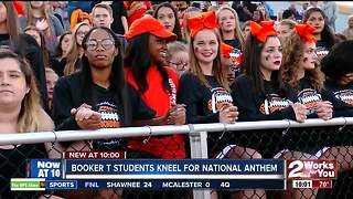 Booker T. Washington High School students join nationwide protest, kneel for national anthem