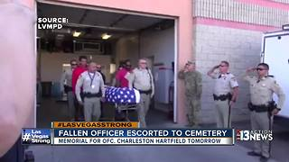Police officer killed in mass shooting escorted to mortuary - Video