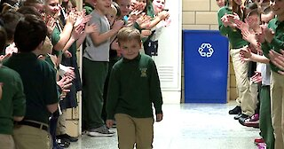 A little boy who beat cancer gets a warm welcome from his entire school