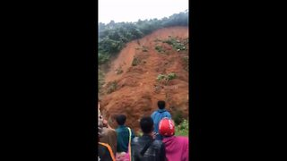 Terrifying moment two men escape death as landslide sweeps away road - Video