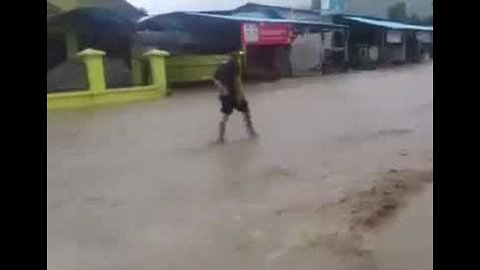 Floodwater Rages Through Streets of Sentani in Indonesia's Papua Province