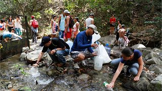 Outside Caracas People Are Getting Water From Streams