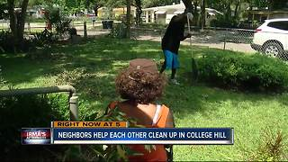 Neighbors help each other clean up after Irma
