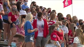 Indiana HS football game starts with little social distancing, mask wearing
