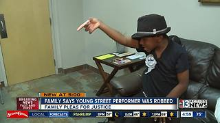 Family says 8-year-old street performer was robbed