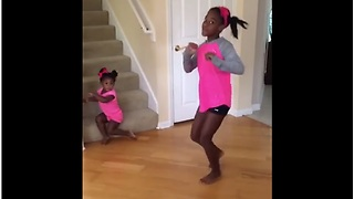 Toddler Steals Sister's Solo Dance Show Without Noticing - Video