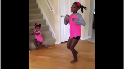 Toddler Steals Sister's Solo Dance Show Without Noticing