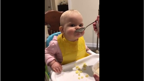 Baby can't figure out big girl spoon