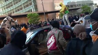 Eyewitness: Women drove car through protesters before being assaulted