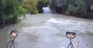 School bus swept away by floodwaters in Texas