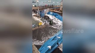 Storm Brian puts new flood defences to work in Fowey, Cornwall - Video